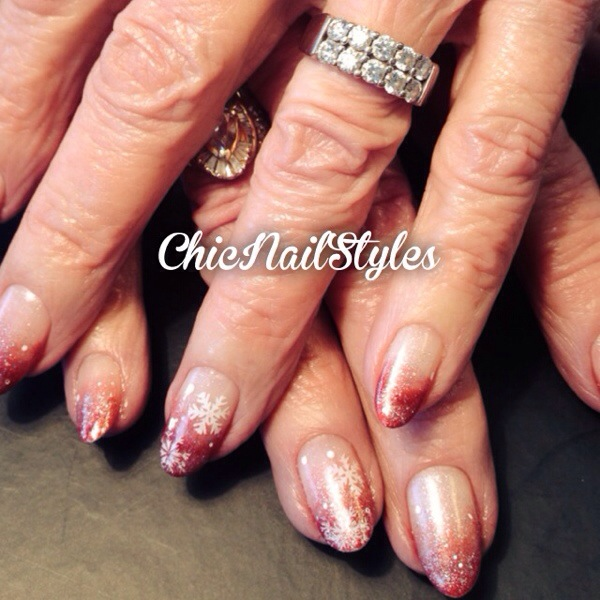 Red ombre nails with glitter and snowflakes