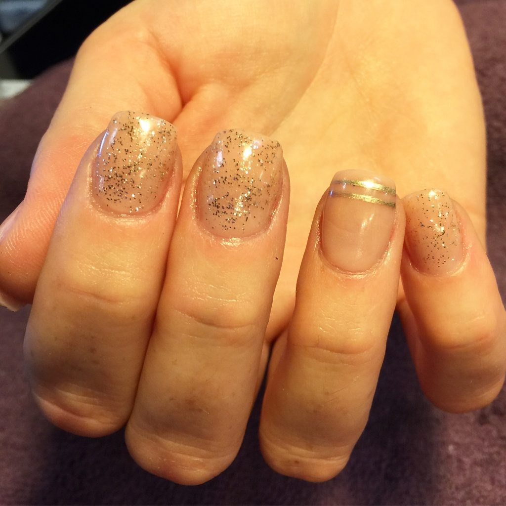 light pink and gold gel nails