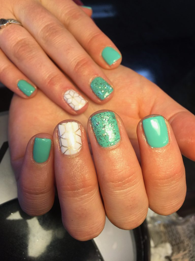 turquoise and white and gold nail art